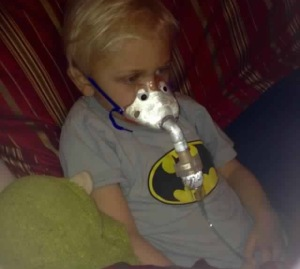 Beck doing a breathing treatment
